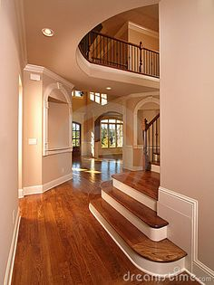 Model Luxury Home Interior Hallway with stairs on right