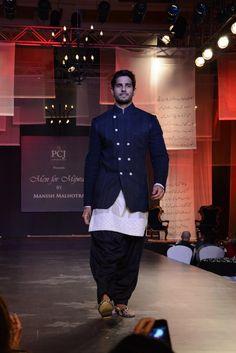 Sidharth Malhotra during `Men for Mijwan` fashion show at Grand Hyatt in Mumbai, on April 1, 2014. (Photo: IANS) #SidharthMalhotra #southasian #mensfashion #bollywood