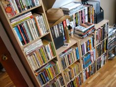 "Anthony Neil Smith's bookshelves:  ""Here is my collection of old pulp novels, plussome favorite writers, and comic books. The stack of books in the middleis my ""currently reading"" pile."""