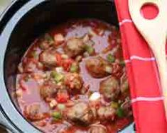 These are big juicy meatballs cooked slowly in a yummy tomato sauce. #KidspotKitchen #KSKitchen