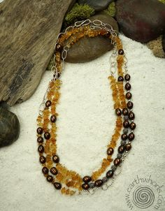 Citrine, fresh water pearls and sterling silver necklace by EarthWhorls.  https://earthwhorls.com/collections/chakra-stones/products/1365sn One of a kind, handmade, free shipping and gift wrap, easy online shopping.