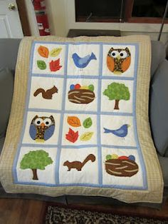 Fall themed baby quilt. Appliqued blocks with 6 various designs.
