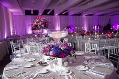 variety of centerpiece treatments, floating candles, large floral balls, low garlands, candlelight