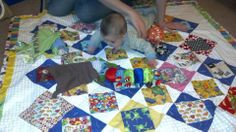 Lily enjoying her quilt from her great Aunt