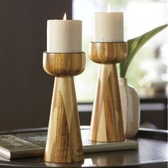 """Wood Candleholder Multi-shades of wood form a smooth, curved holder. Metal inset holds up to 3"""" pillar candle."""