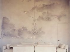A creamy, dreamy mural is the star of this room.