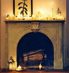 love the warm glow of candles around this beautiful fireplace  #home #decor