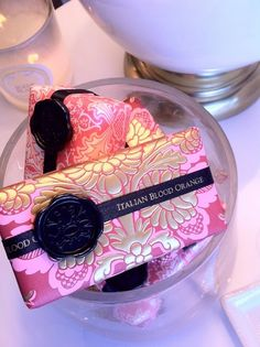 These are among the collection of pretty soap packages in a bathroom. And no, they're not there to wash with, silly! Why would we ever wash with the soap? Not when the package is this pretty.