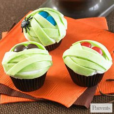 Scale down on the sweets with mini mummies. These chocolate cupcakes are all wrapped up in sour apple bubble gum tape. They are almost too cute to eat!