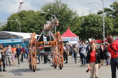 Remote controlled Giraffe Robot on wheels blaring music everywhere it goes