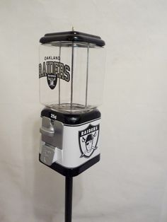Vintage Acorn Gumball Vending Machine, completely restored and themed to Oakland Raiders This Machine is all metal complete with all original components including: * Machine Base & Body black and whit Oakland Raiders Logo, Raiders Girl, Nfl Oakland Raiders, Raiders Football, Car Part Furniture, Automotive Furniture, Automotive Decor, Furniture Design, Sport Themed Crafts