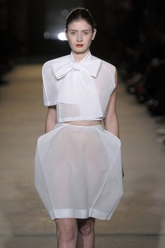 A blend of strong and soft... sculptural dress with harsh edges on delicate sheer fabric // Celine Meteil SS11