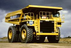 Similar Dump Trucks used to haul Iron Ore & Rock waste at our local Iron Mines.  My Husband and both Sons as College Students for Summer EEs have driven these production trucks.  They say it is like driving a house!!  HUGE!!