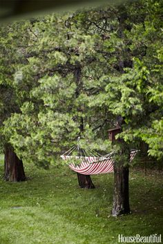 """This red-striped hammock hangs between two trees outside design consultant Ellen O'Neill's home. """"I felt like I had run into an old friend when I saw this hammock at IKEA,"""" she says. See inside O'Neill's Bridgehampton cottage »"""