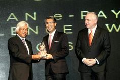 (From left) Muhammad, CIMB group chiefv executive Tengku Datuk Seri Zafrul Aziz and Schiesser at the Malaysian E-Payment Excellence Awards.