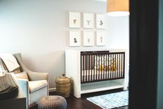 A modern safari themed nursery designed by Widell Designs for a stylish baby boy.