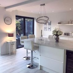 Softly lit Scandinavian inspired white modern contemporary open plan kitchen living room with bi folding doors. Open Plan Kitchen Dining Living, Living Room Kitchen, Living Room Modern, New Kitchen, Living Room Designs, Kitchen Decor, Kitchen Ideas, Awesome Kitchen, Open Plan Living