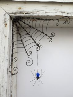 "Czechoslovakian Blue Spider Dangles From 12"" Barbed Wire Corner Spider Web"