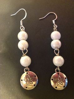 Handmade White pearl sanddollar earrings