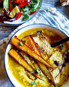 Warm & creamy roasted carrot soup with coconut milk, fresh ginger & turmeric topped with a drizzle of toasted sesame oil and toasted sesame seeds. This is an easy soup to whip up in the blender and is savory & delicious on a fall day! #soup #fallsoup #farmtotable #farmfresh #eatyourvegetables #feedfeed #grownyc #cookinglight #thenewhealthy #eatingwelleats #foodandwine #hautecuisines #epicurious #foodandwine #thisisfall #veganfoodshare #plantbased #poweredbyplants #whol...
