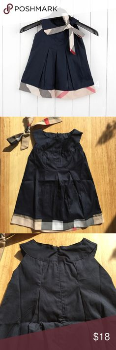 NEW! Baby Dress NEW! Baby dress in navy blue with plaid accent. Size is 18-24m Dresses