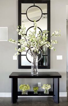 nts: try w/ framed mirror just adding circlesbeautifully decorated entry way console table