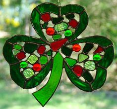 STAINED GLASS CELTIC CLOVER LEAF in TRANSLUCNET REDS & GREENS....HAND MADE IN AUSTRALIA....$49.99
