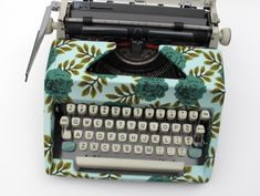Fabric covered typewriter. This reminds me of my childhood and joys of Mod Podge.