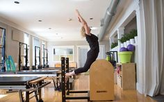 Lisa Johnson, owner of Modern Pilates, busting a move at her studio on the ladder barrel.