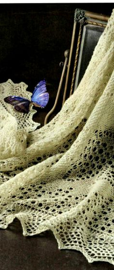 The Orenburg lace downy shawl is traditional Russian folk craft and fashionable attribute