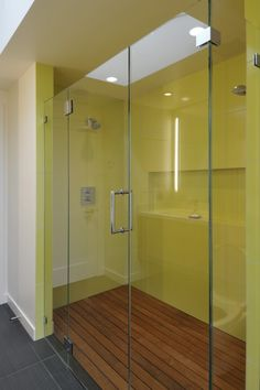 This threshold shower, which almost qualifies as a less-than-zero design, successfully combines two different flooring materials. The wood boards in the shower are spaced to provide drainage and prevent water from pooling. In a design like this, it's important to make the floorboards removable so the drain can be accessed easily.