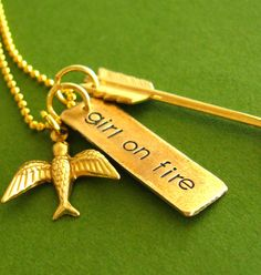 Hunger Games Necklace - Girl on Fire - Mockingjay and Arrow in brass and gold plated - Katniss Everdeen