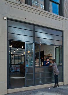 Manifold Architecture Studio, coffee shop exterior with folding back windows. Cafe Bar, Cafe Shop, Shop Interior Design, Retail Design, Store Design, Cafe Exterior, Modern Exterior, Craftsman Exterior, Exterior Paint