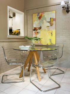 Glass and perspex furniture creates the illusion of more space. This is also true of upholstered furniture which has legs rather than extending the upholstery all the way to the floor.
