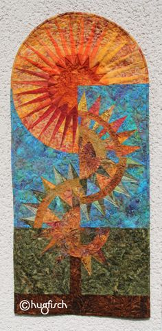 Tree of life. A wallhanging made out of a whole bunch of Batiks and with blocks of a NYB pattern