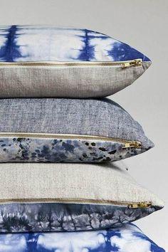 Throw pillows, indigo blue, linen, tie dye and denim with brass zippers.