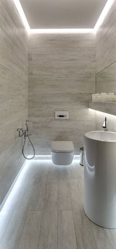 i think it would a great idea for their guests if john doesnt want a shower room in the toilet. I like the hidden lighting at both the intersections with the wall (floor & ceiling) simple Bad Inspiration, Bathroom Inspiration, Interior Lighting, Lighting Ideas, Ceiling Lighting, Bathroom Ceiling Light, Lighting In Bathroom, House Lighting, Accent Lighting
