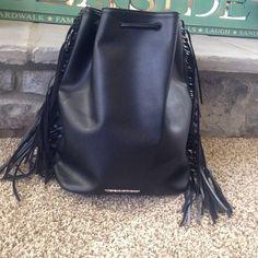 VS black leather backpack NWT. Never worn before. fringe on the side Victoria's Secret Bags Backpacks