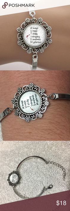 "Autism Bracelet Very beautiful bracelet for autism Awareness. The metal is zinc alloy. Glass cabochon pendant. Has a lobster clasp and chain extender. New in package. Can be worn anywhere from about 5-7"". Jewelry Bracelets"