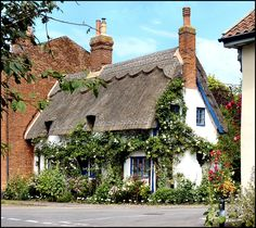 Lovely thatched cottage in Walpole. Suffolk. It looks quite idyllic adorned with roses.
