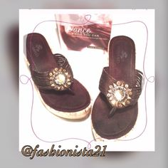 """Nomad Wedge Shoes Brown 6.5 Hot wedges. Brown with gold bling and 4"""" heel. Pre owned. Normal wear on soles and insoles. Beautiful gold and brown sequined embellishments in the shape of the sun. Nomad Shoes Wedges"""