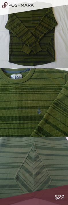 Long Sleeve Thermal Striped Crew Neck By Volcom This is a brand new, green Volcom sweater with horizontal stripes of various sizes. The emblem is sewn into the upper right chest of the torso in black thread, and the logo is sewn into the upper right of the back in blue. It also has a Volcom shaped seam sewn into the lower left portion of the abdomen that looks really cool! This shirt is very flattering and makes you look really muscular:o) Volcom Sweaters Crewneck