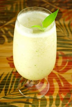 Sexy Monkey  2 cups crushed ice   1 ripe banana   2 tablespoons cream of coconut   2 ounces pineapple juice   3 ounces banana rum     Put all ingredients into a blender and blend until no ice chunks remain. Garnish with pineapple sage, if desired.