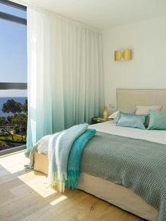 Turquoise hues in the bedroom complement the sea views perfectly too, for a complete in-outdoor experience!