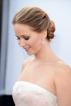 Jennifer Lawrence -- Wearing 110 carat earrings and diamond chain from Chopard