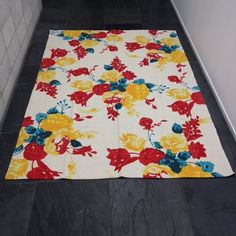 Blue, red and yellow flower rug