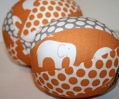 Organic Fabric Rattle Ball - Elephant Parade - Orange and Grey - Boy or Girl - Baby or Toddler. $12.00, via Etsy.
