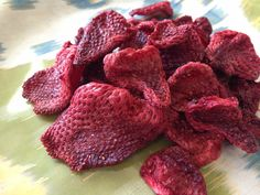 I spotted this recipe for oven-dried strawberries on Pinterest and decided to give it a try. I picked up a pint of local organic strawberries...