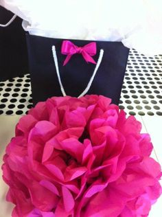 black and white gift bag with a pop of pink perfect for a wedding