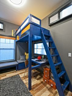 Bedroom: Vibrant Blue Loft Bed With Desk Underneath. blue loft bed. desk under bed. wood flooring. window seating.